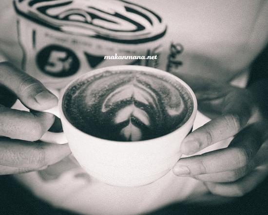 Coffee 45 leo holding mocha